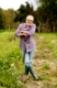 farming, gardening, agriculture and people concept - happy senior man with shovel at garden or farm