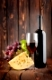 Red wine with cheese on a wooden background