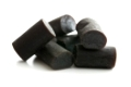 Black liquorice candies isolated on white background.