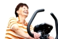 Senior woman exercise on spinning bicycle at home
