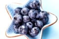 Blueberries close up in a blue bowl