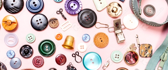top view of many various sewing objects on pink background