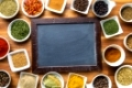 Blank chalkboard and various spices. Top view.