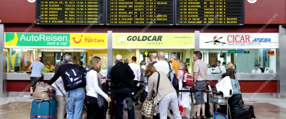 Car rental offices at Tenerife south airport with queues of people, Canary Islands, Spain