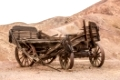 Old wooden broken wagon in calico ghost town, USA