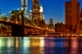Brooklyn Bridge with lower Manhattan skyline in New York City at night