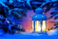 candle light lantern in snow