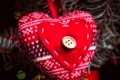 Handmade knitted heart - christmas decoration on the fir branch