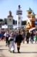 MUNICH, GERMANY - SEPTEMBER 23, 2014: The Oktoberfest in Munich is the biggest beer festival of the world. The visitors are walking at the mainstreet with tents of bavarian breweries.