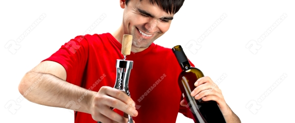 A smiling man with cork screw, looking inside uncorked bottle of wine