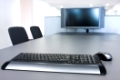 Flat screen and computer keyboard in a meeting room