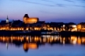 Torun city skyline at twilight in Poland, Old Town at Vistula River waterfront.