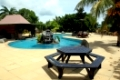 Table, pool and palm tree in the inner yard of hotel in Savaii island, Samoa