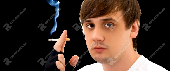 Portrait of the young man with a cigarette. Isolated