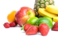 Arrangement of various fresh ripe fruits: pineapple, bananas, orange,  apple, limes and strawberries closeup isolated on white background.