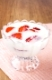 Fresh yogurt with strawberry slices in glass bowl