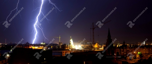 Lightning bolts during thunderstorm in the city