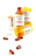 Pills and vials on white background